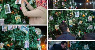 شجرة الكرسمس في ساحة التحرير تتزين بصور الشهداء